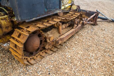 tread: Caterpillar track, continuous track or tank tread on old vehicle. Stock Photo