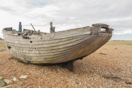 dungeness: Old wooden boat. Dungeness Beach, Kent, England, United Kingdom. Stock Photo