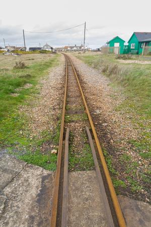 narrow gauge railroads: Romney, Hythe& Dymchurch Railway railroad, close up of tracks, Dungeness, Kent, England, United Kingdom. Stock Photo