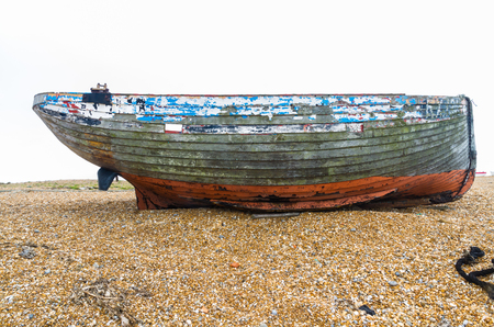 flaking: Old wooden boat with flaking paint. Dungeness Beach, Kent, England, United Kingdom.