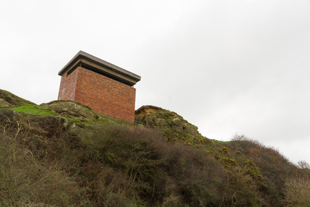 an invasion: Brisk shuttered WWII Observation Post. Anti invasion measure, part of the Coastal Crust. Pett Level, Hastings, Kent, England, United Kingdom. Stock Photo