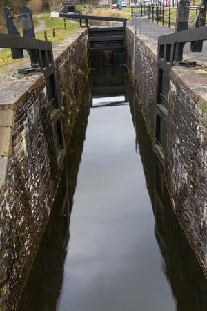 lift gate: Closed single gate lock. Clyne, Vale of Neath, Port Talbot, Wales, United Kingdom.