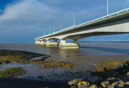 ail: The Second Severn crossing is a bridge that carries the M4 motorway over the Bristol Channel or River Severn Estuary between England and Wales, United Kingdom. Morning light from East.