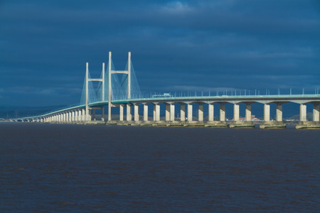 bristol channel: The Second Severn crossing is a bridge that carries the M4 motorway over the Bristol Channel or River Severn Estuary between England and Wales, United Kingdom. Morning light from East.