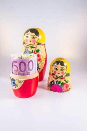matriosca: Roll of 50 Euro notes hidden in matryoshka Russian doll.