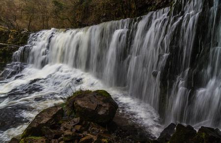 waterfall: Sgwd Isaf Clun-Gwyn Falls, waterfall. Pontneddfechan, Vale of Neath, Powys, Wales, United Kingdom, winter. Stock Photo
