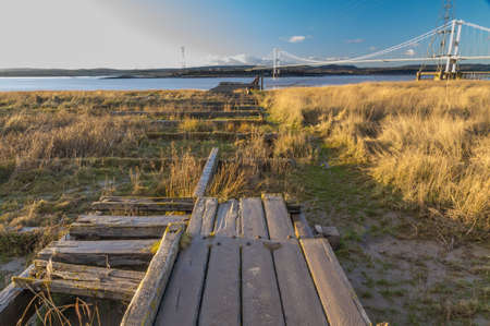 severn: Old wooden pier which was for the Aust ferry that crossed River Severn to Beachley. United Kingdom.