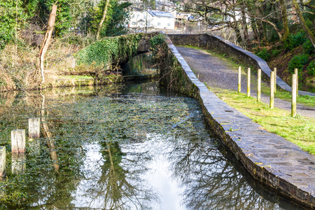 vale: Skew bridge or arch, over the Neath Canal. Aberdulais , Vale of Neath, Port Talbot, Wales, United Kingdom. Stock Photo