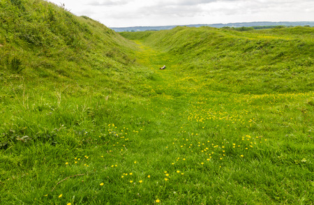 ditch: Ditch of Iron age hill fort Badbury Rings. Wimborne, Dorset, England, United Kingdom. Stock Photo