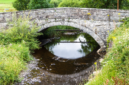 river county: Old stone back bridge, with over Afon Merddwr river. Pentrefoelas, Conwy County, Wales, United Kingdom, Europe
