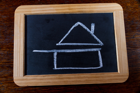 cook house: Blackboard with chalk symbol of home cooked food as drawn by child. Pan with roof.