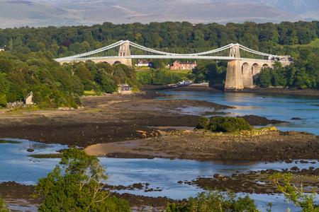 snowdonia: Thomas Telford�??s Menai Bridge carries a road across the Menai Straits between, Snowdonia and Anglesey. Wales, United Kingdom