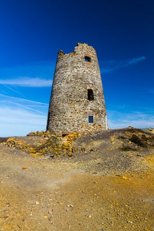 derelict: Parys Mountain ex quarry with derelict lighthouse. Amlwch, Anglesey, Wales, United Kingdom