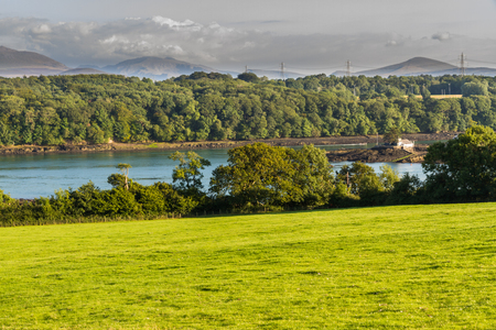 straits: Looking East across the Menai Straits to Snowdonia, from Anglesey, North Wales, United Kingdom. Stock Photo