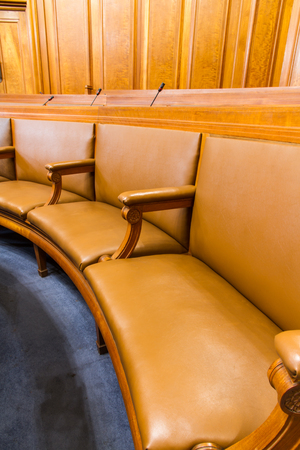chamber: Wood and leather seats in a council chamber. Wood and leather upholstered.