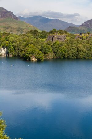 disused: Disused Dorothea Slate Quarry, Nantlle, Gwynedd, Wales, United Kingdom. Cornwall Quarry Flooded with water. Snowdon in background