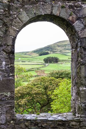 nant: View through arch of the ruin of the Pont y Pandy slate processing mill. Snowdonia, North Wales, United Kingdom