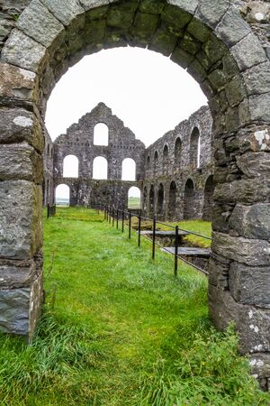snowdonia: View through arch of the ruin of the Pont y Pandy slate processing mill. Snowdonia, North Wales, United Kingdom