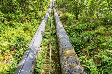 hydro electric: Two water pipes. The pipeline carries water from llyn or Lake Trawsfynydd to the Maentwrog hydro electric power station Stock Photo