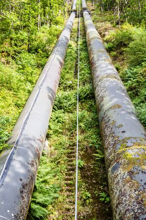 hydro electric power station: Two water pipes. The pipeline carries water from llyn or Lake Trawsfynydd to the Maentwrog hydro electric power station Stock Photo