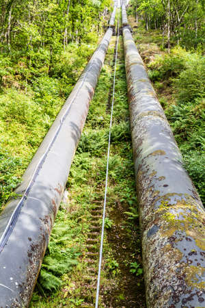 hydro electric: The pipeline carries water from llyn or Lake Trawsfynydd to the Maentwrog hydro electric power station Stock Photo