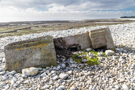 pillbox: WWII pillbox sinking into Aberthaw beach, South Wales, United Kingdom, Europe