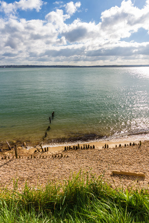 exbury: Pebble beach with worn defences and Isle of Wight in distance. Lepe Country Park, Exbury Southampton, Hampshire, England, United Kingdom