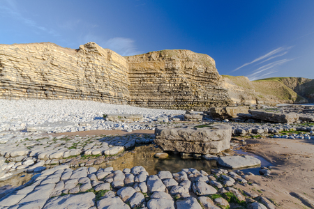 carboniferous: Carboniferous limestone cliffs of Southerndown Beach or Dunraven Bay, afternoon light. Used as Bad Wolf Bay in Doctor Who. South Wales, UK.