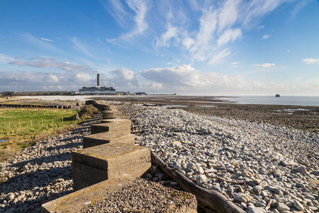 repel: Anti Tank Cubes on beach leading to Aberthaw B Coal Fired Power Station, South Wales, UK.