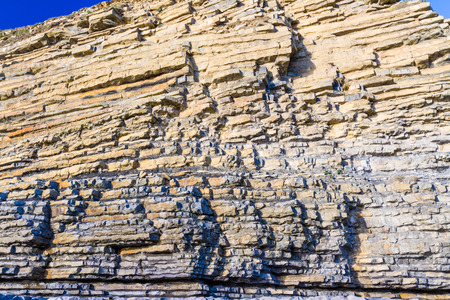 Carboniferous limestone cliffs of Southerndown Beach or Dunraven Bay, afternoon light. Used as Bad Wolf Bay in Doctor Who. South Wales, UK.