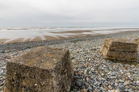 world war ii: Anti-tank cubes from World War II to prevent invasion. Fairbourne beach, North Wales, United Kingdom, Europe Stock Photo
