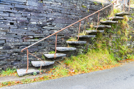 Set of cantilevered steps, made of slate ascending wall. Stock Photo