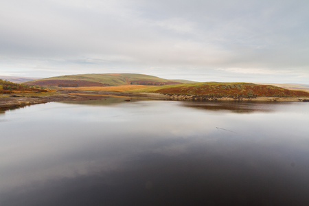 wales: The Claerwen Reservoir part of Elan Valley Reservoirs on a still Autumn Fall morning. Powys, Wales, United Kingdom. Stock Photo