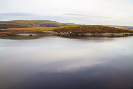 elan: The Claerwen Reservoir part of Elan Valley Reservoirs on a still Autumn Fall morning. Powys, Wales, United Kingdom. Stock Photo