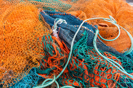 Fishing nets piled together at fishing village