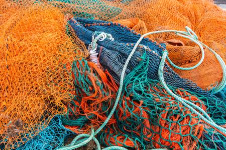 redes de pesca: Redes de pesca amontonadas junto al pueblo pesquero
