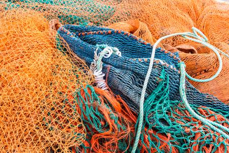 jumbled: Fishing nets piled together at fishing village