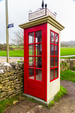 earliest: Earliest model of standard UK telephone kiosk, the K1. This is a replica after the original was accidentally destroyed during the filming of the 1986 film Comrades. Tyneham, Dorset, England, United Kingdom.