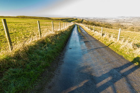uplands: Small road on Eggardon Hill, Dorset, United Kingdom. Sunny winter day.