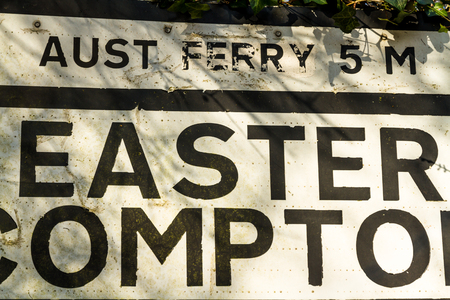 anachronistic: Sign for village of Easter Compton still shows distance to Aust Ferry which closed down in 1966 Stock Photo