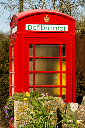 're: English red telephone call box re-used as a defibrillator Stock Photo