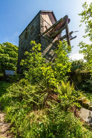 Derelict beam engine at the the disused Dorothea Slate Quarry, Nantlle, Gwynedd, Wales, United Kingdom. Stock Photo