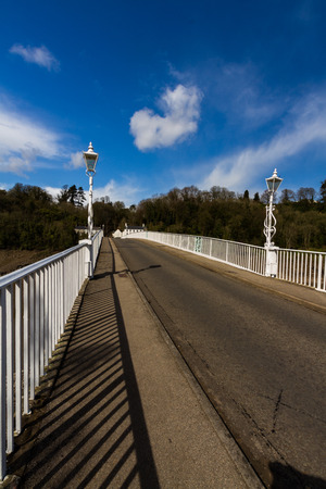 Old road bridge over River Wye connecting Chepstow, Wales and Tutshill England.