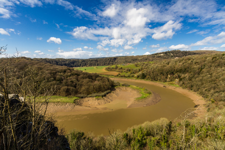 The tidal River Wye from the limestone cliffs of Wintourâ??s Leap, at Woodcroft, Gloucestershire, England, United Kingdom.