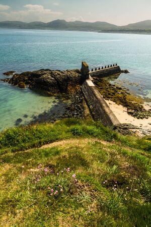 Breakwater at Porthdinllaen, Morfa Nefyn, Llyn Peninsula, Gwynedd, Wales, United Kingdom Фото со стока