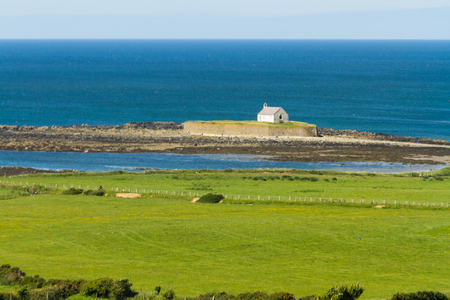 Looking out to see at high tide at St Cwyfanâ??s Church, the Church in the Sea. Llangwyfan, Aberffraw, Anglesey, Wales, United Kingdom, Europe Stock Photo