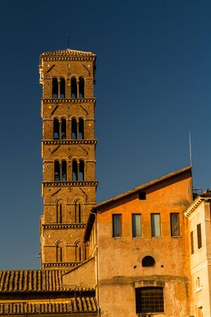 corinthian column: Tower of the Antiquarium Museum in Rome, evening light.
