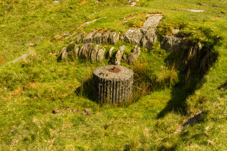 Concrete WWII base for a Spigot Mortar. Idwal Cottage, Snowdonia National Park, Gwynedd, Wales, United Kingdom.