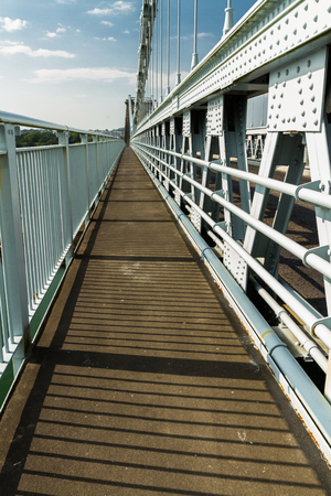 Walkway of the Menai bridge by Thomas Telford. Crossing the mania Straits between island of Anglesey and mainland Wales,