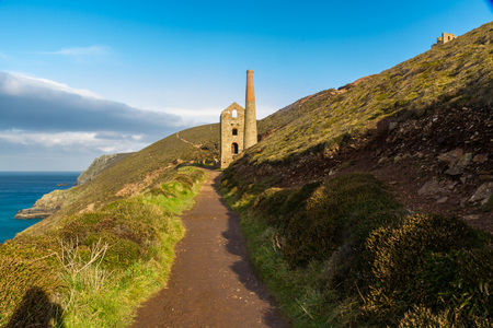 mine site: South west coast path approaching Towanroath shaft Engine House part of Wheal Coates tin mine Stock Photo
